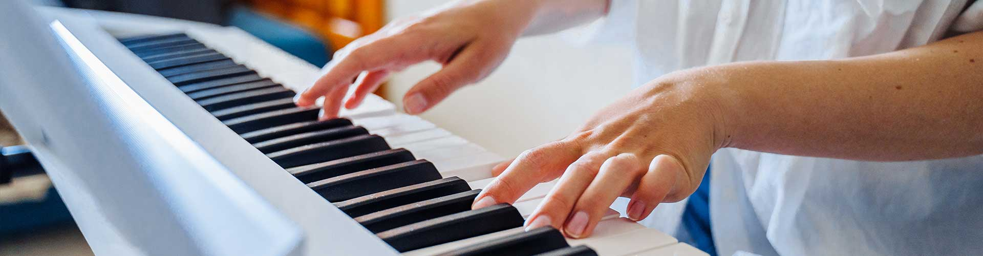 Adult leaning piano