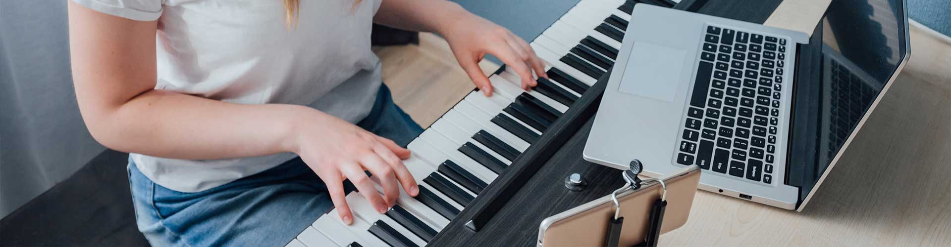 Teenager leaning piano